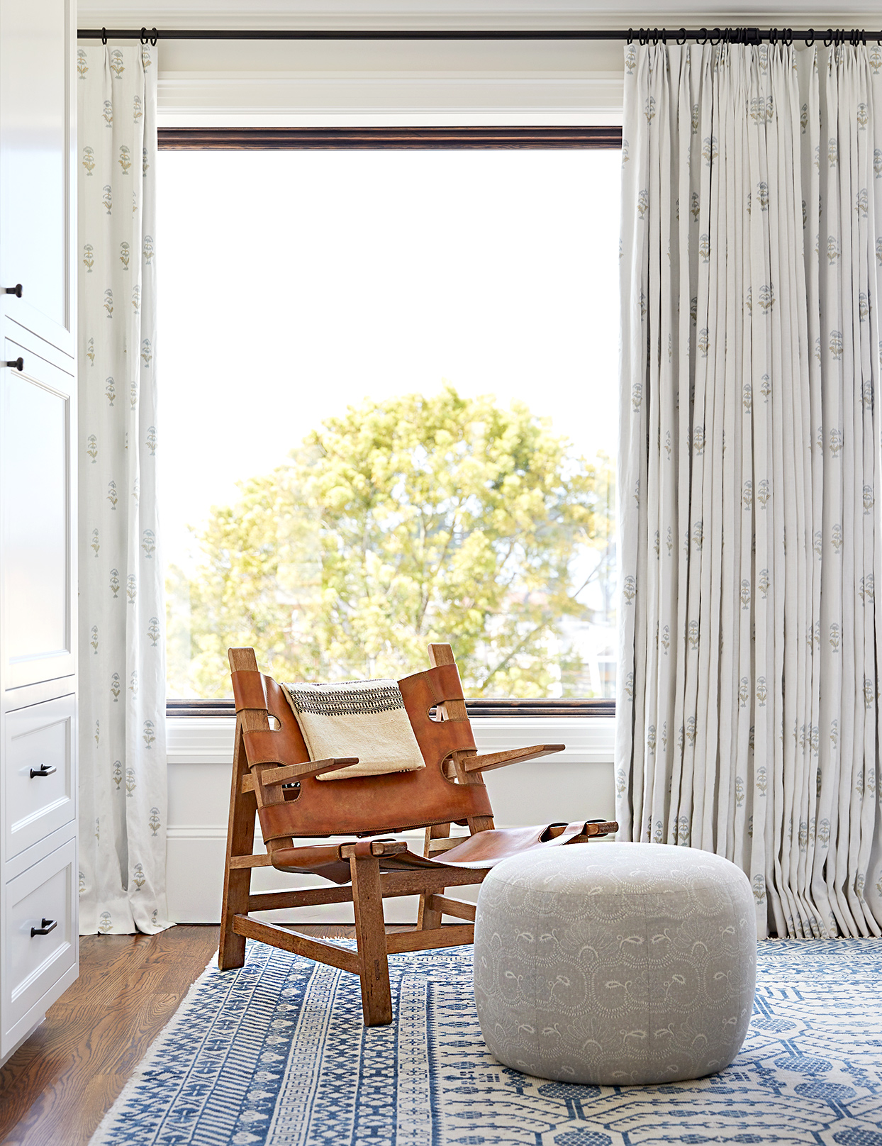 Chair on front of window with ottoman