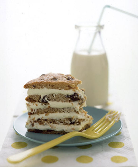 """A hit with both kids and adults, this """"cake"""" is actually five enormous semisweet chocolate chip cookies slathered in cream cheese frosting."""