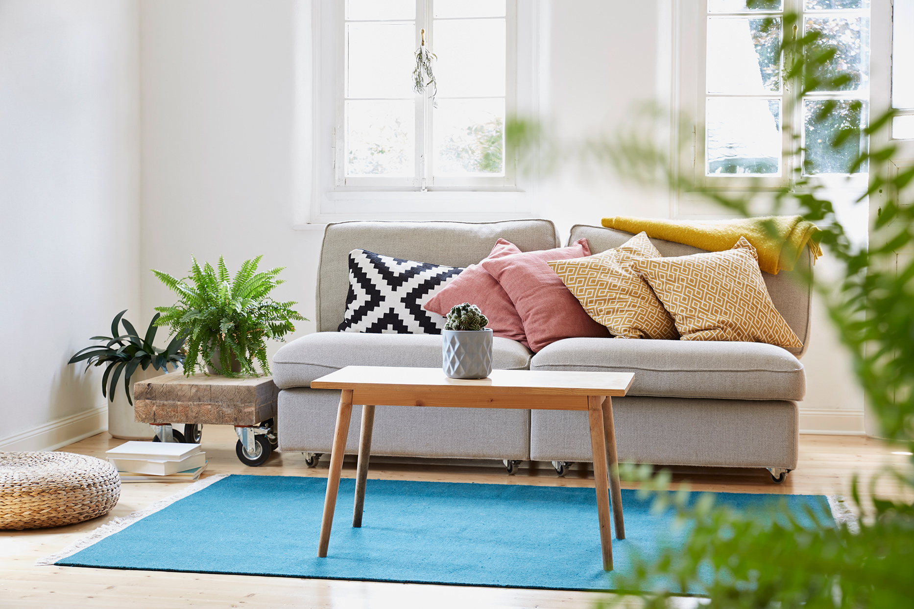 Living room with gray couch and wooden coffee table