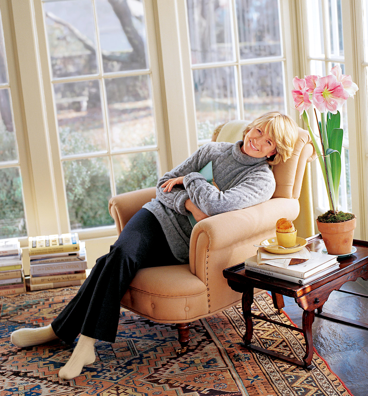 Martha Stewart sitting on chair in February 1998