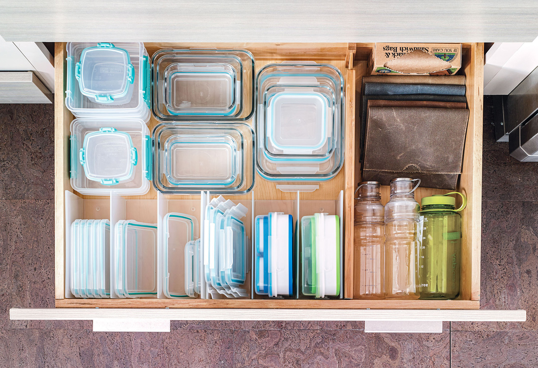 kitchen drawer filled with stackable containers