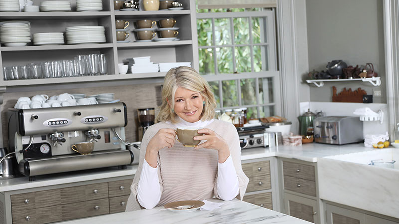 Martha Stewart drinking coffee in her kitchen