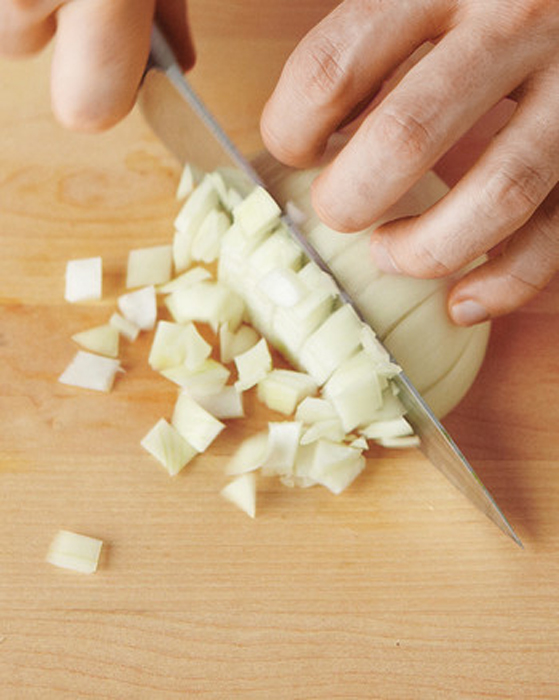 knife dicing an onion