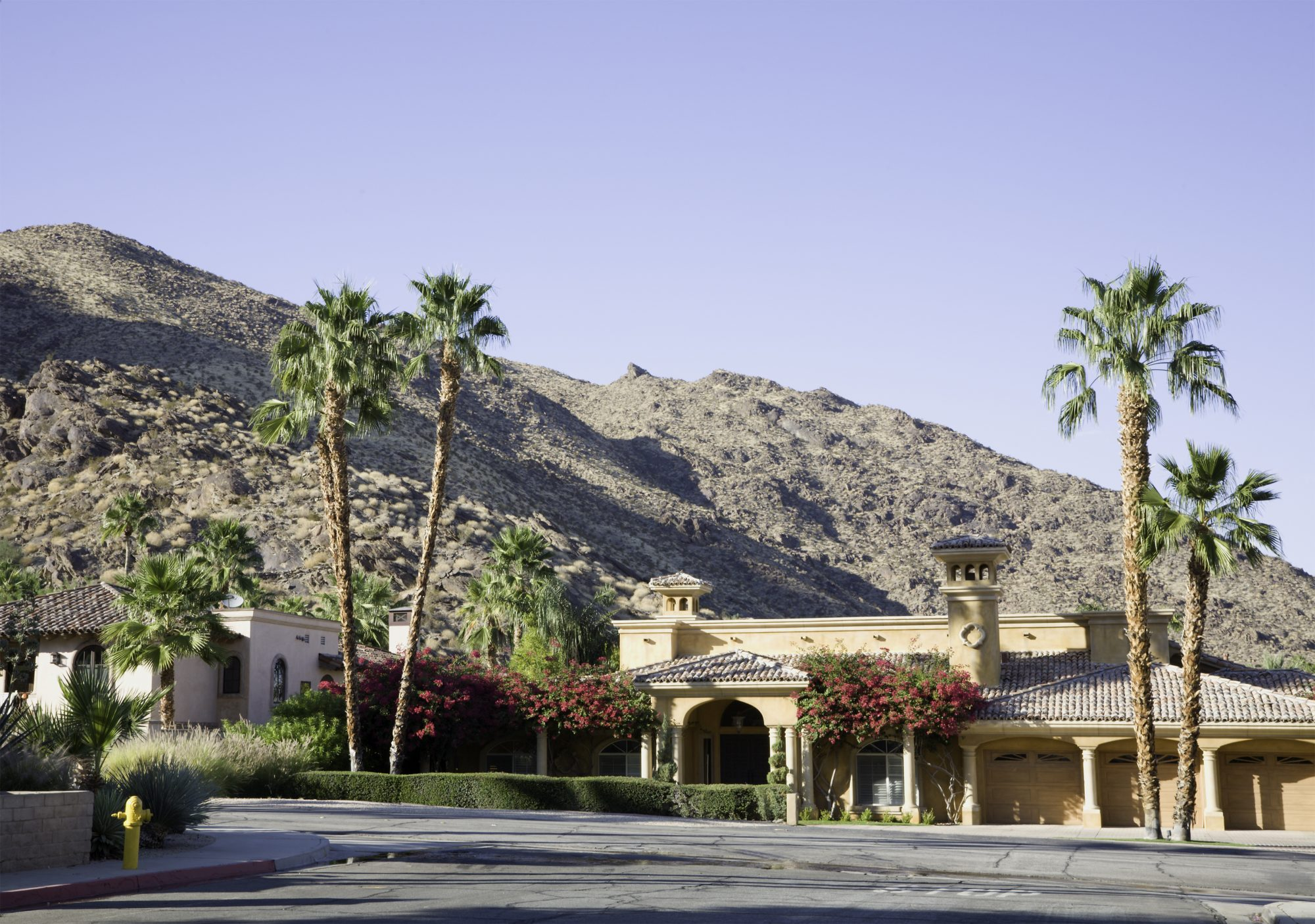 Spanish Architecture located against the rocky mountain terrain of the desert in Palm Springs