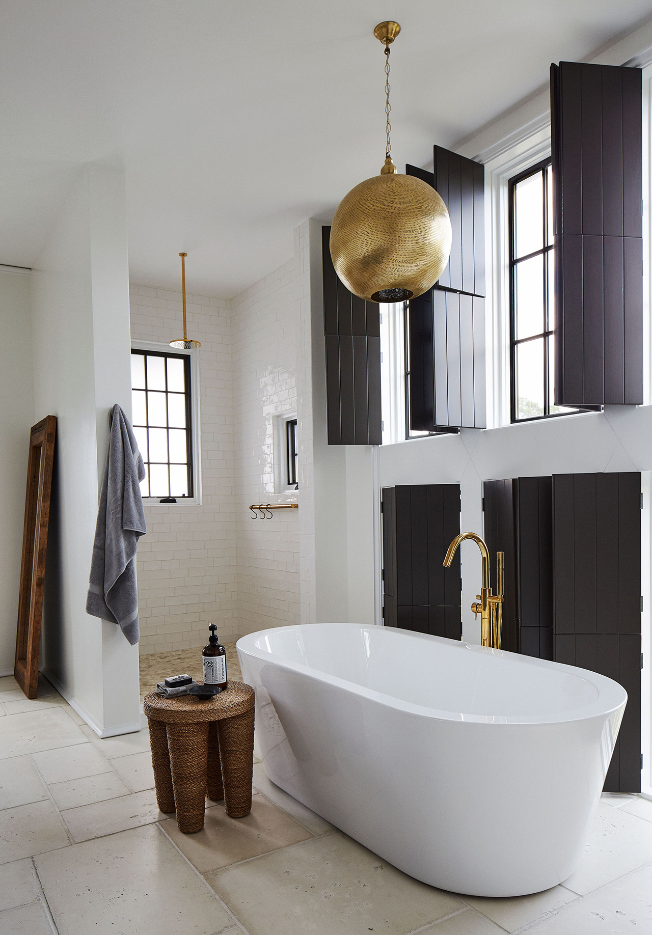 Moroccan-style master bathroom hanging gold lights