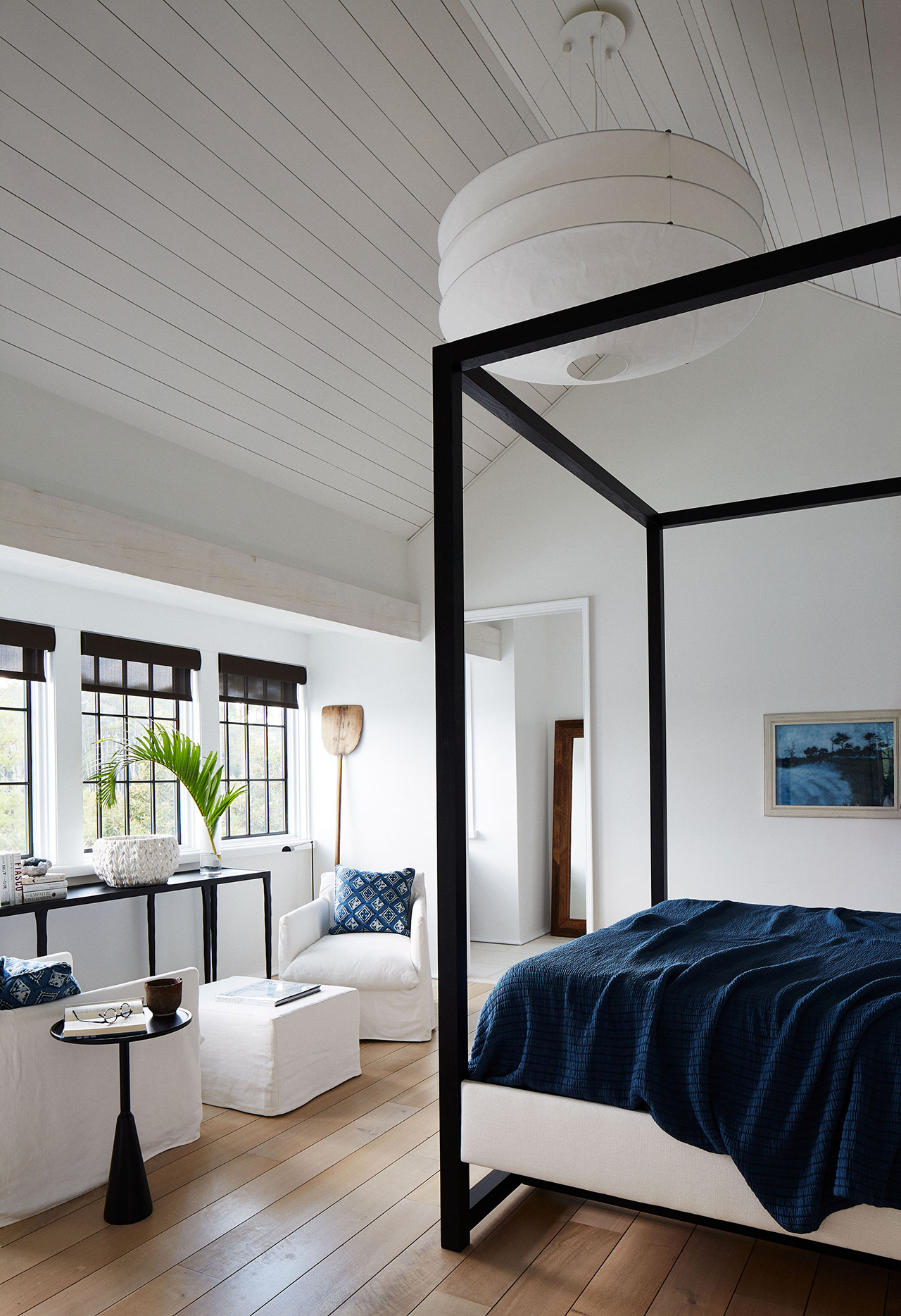 airy master bedroom club chair four-poster bed