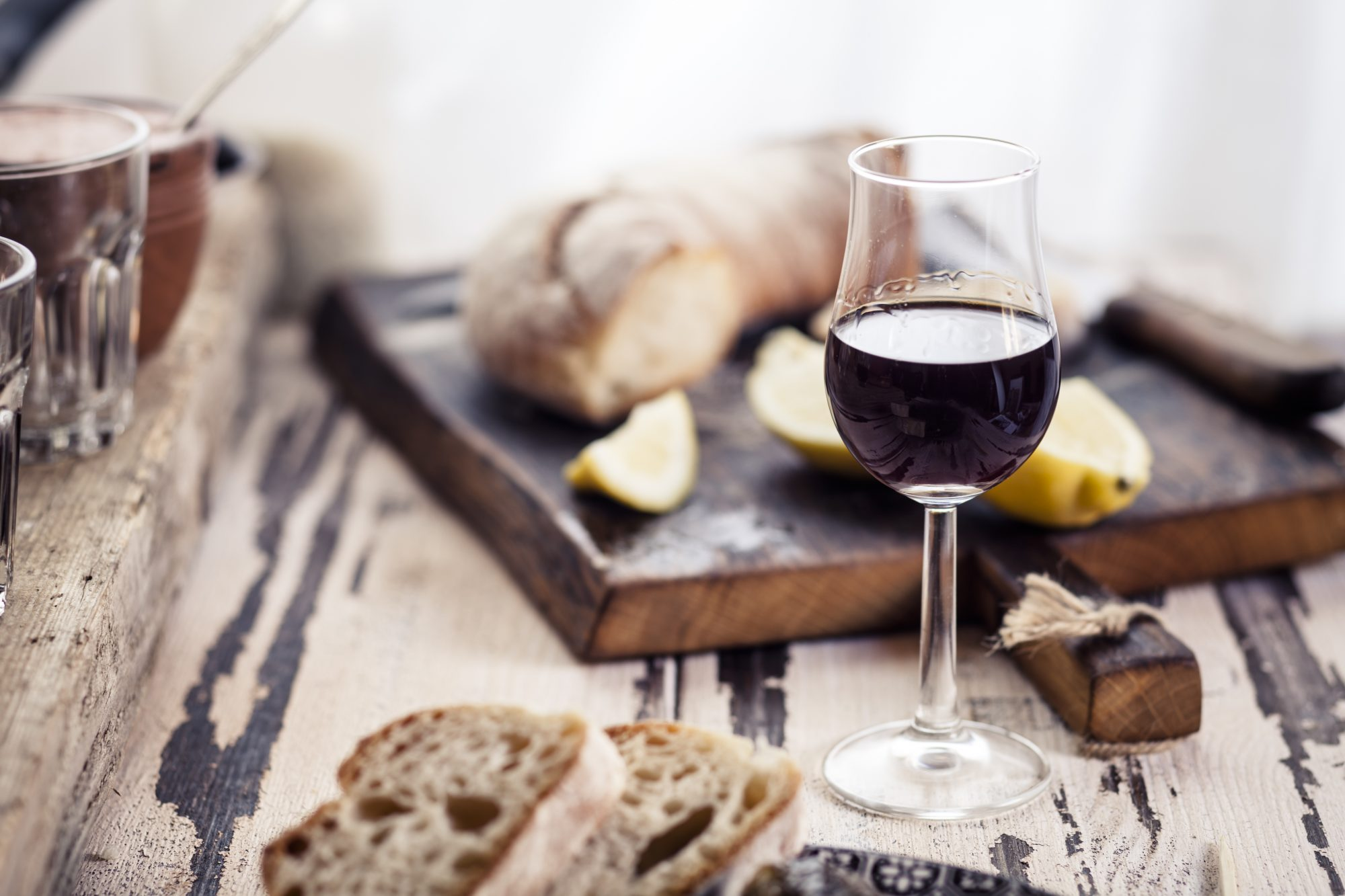 glass of port with bread and fruit