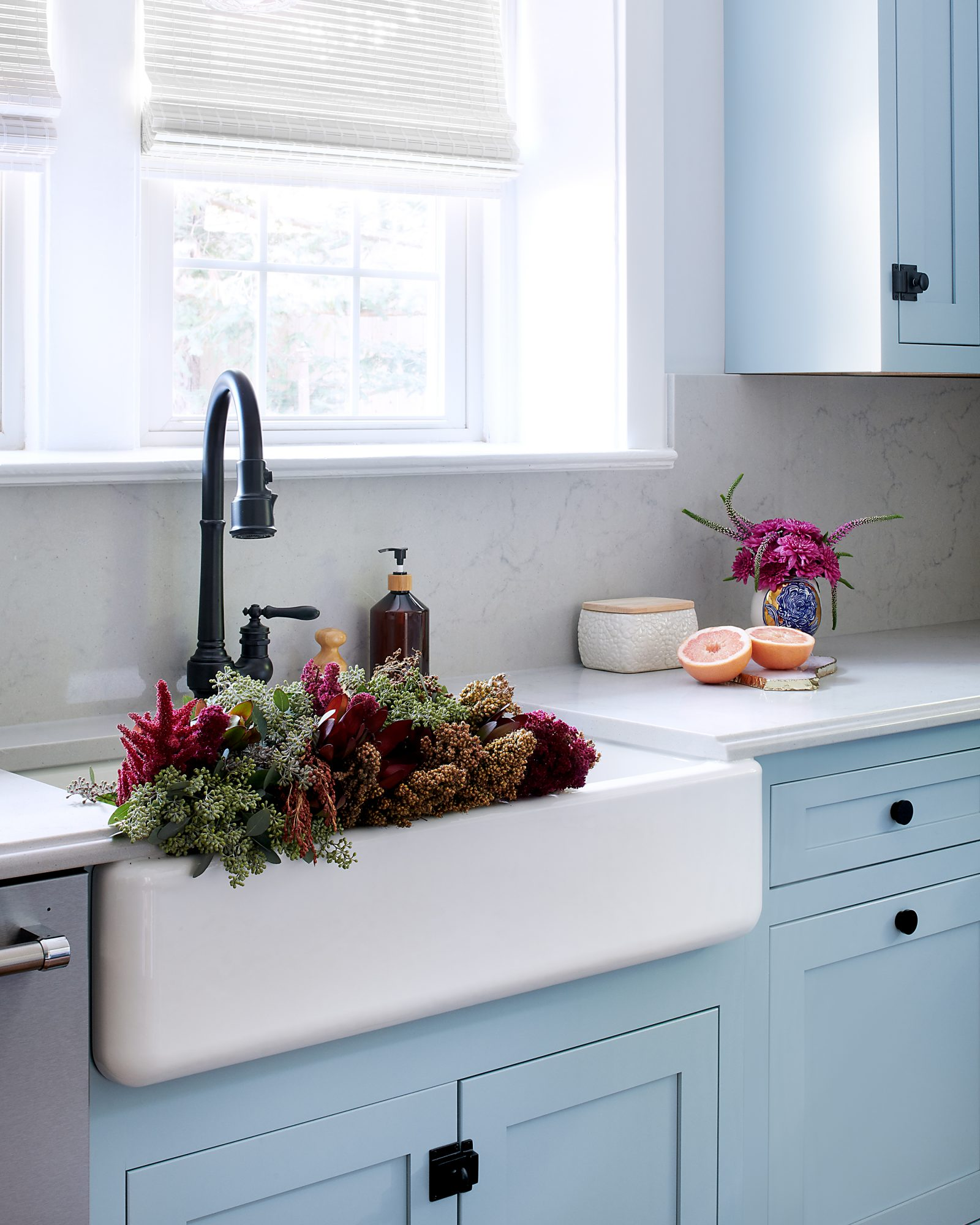 powder blue kitchen with view of sink details
