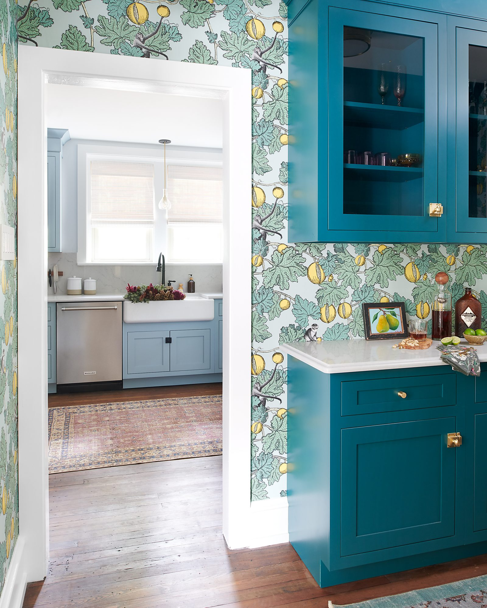 powder blue kitchen with floral wall paper