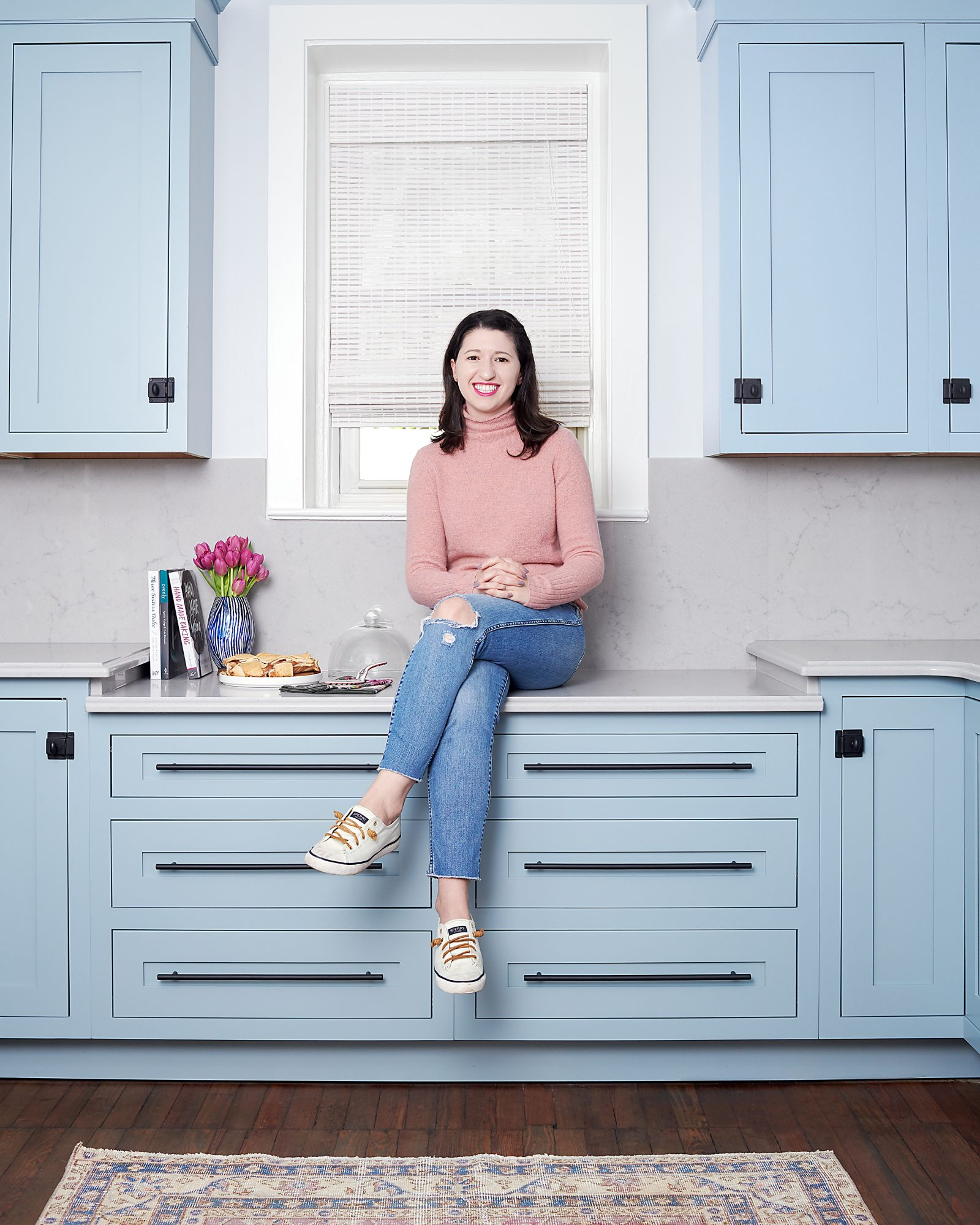 michelle gage sitting in powder blue kitchen