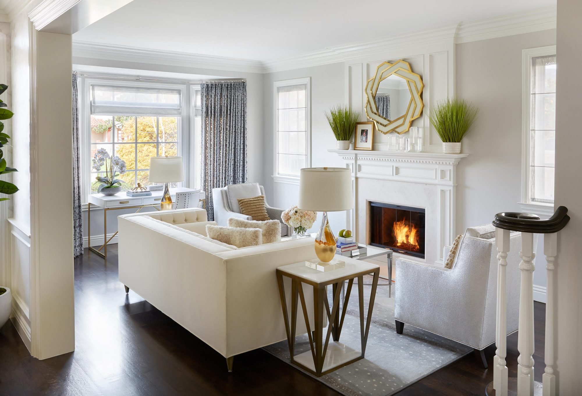 white living room color scheme with gold accents