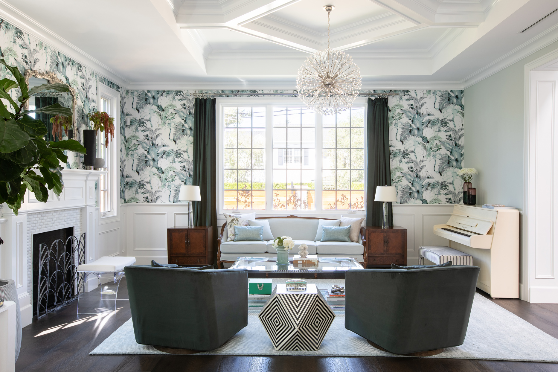 green and white print wall paper, asymmetrical chair and table furniture set up