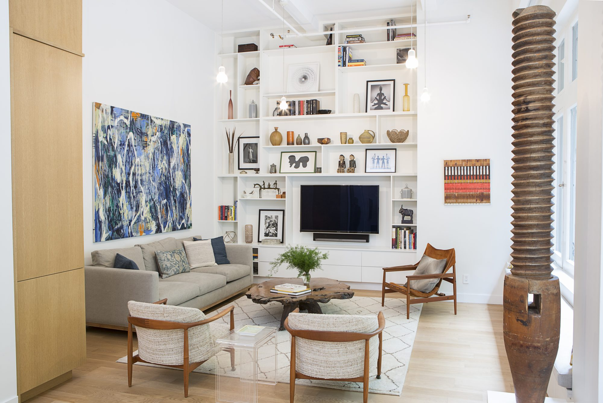floor to ceiling white wall built in shelf living room