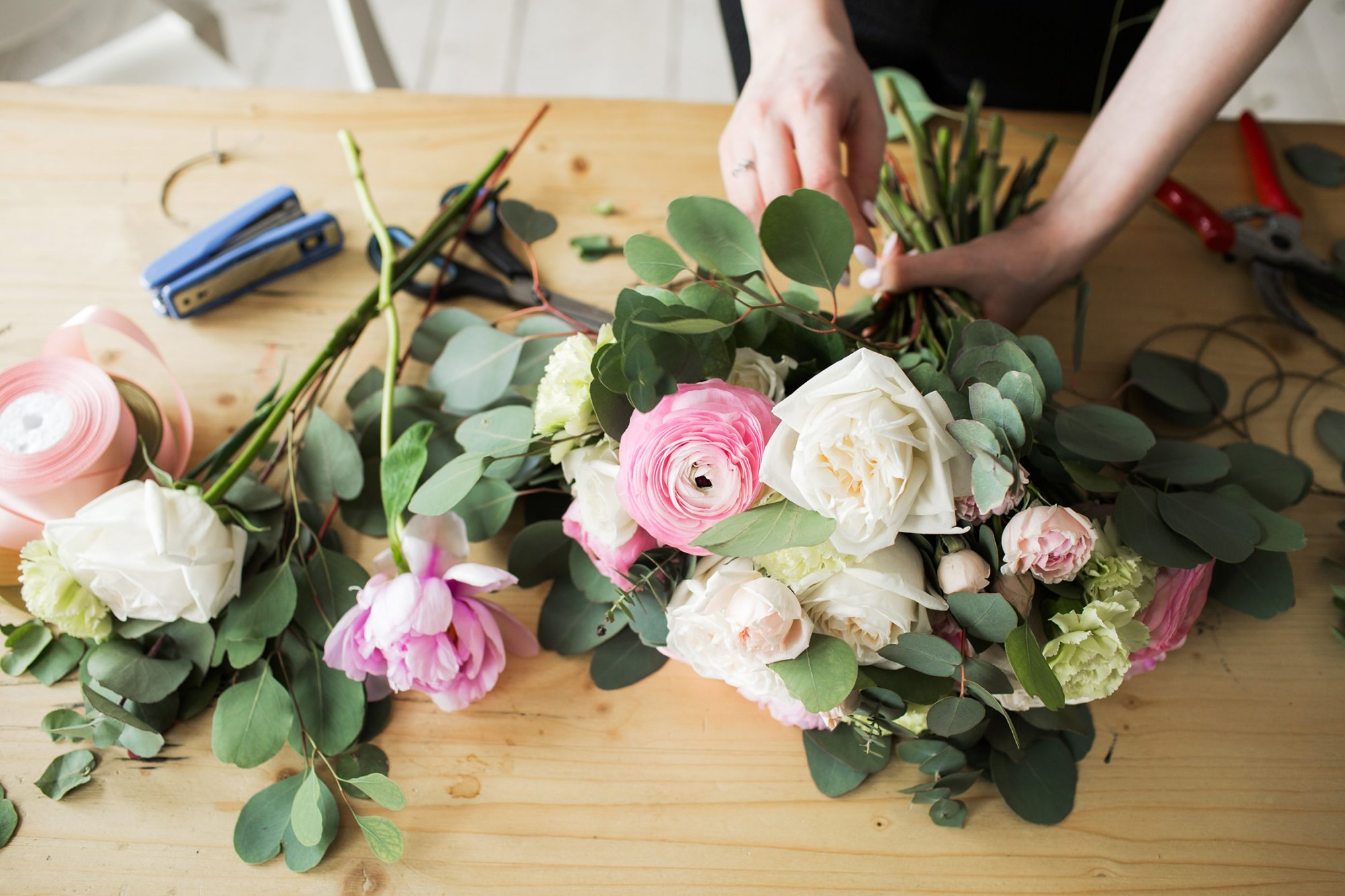 woman making fashion modern bouquet of different flowers