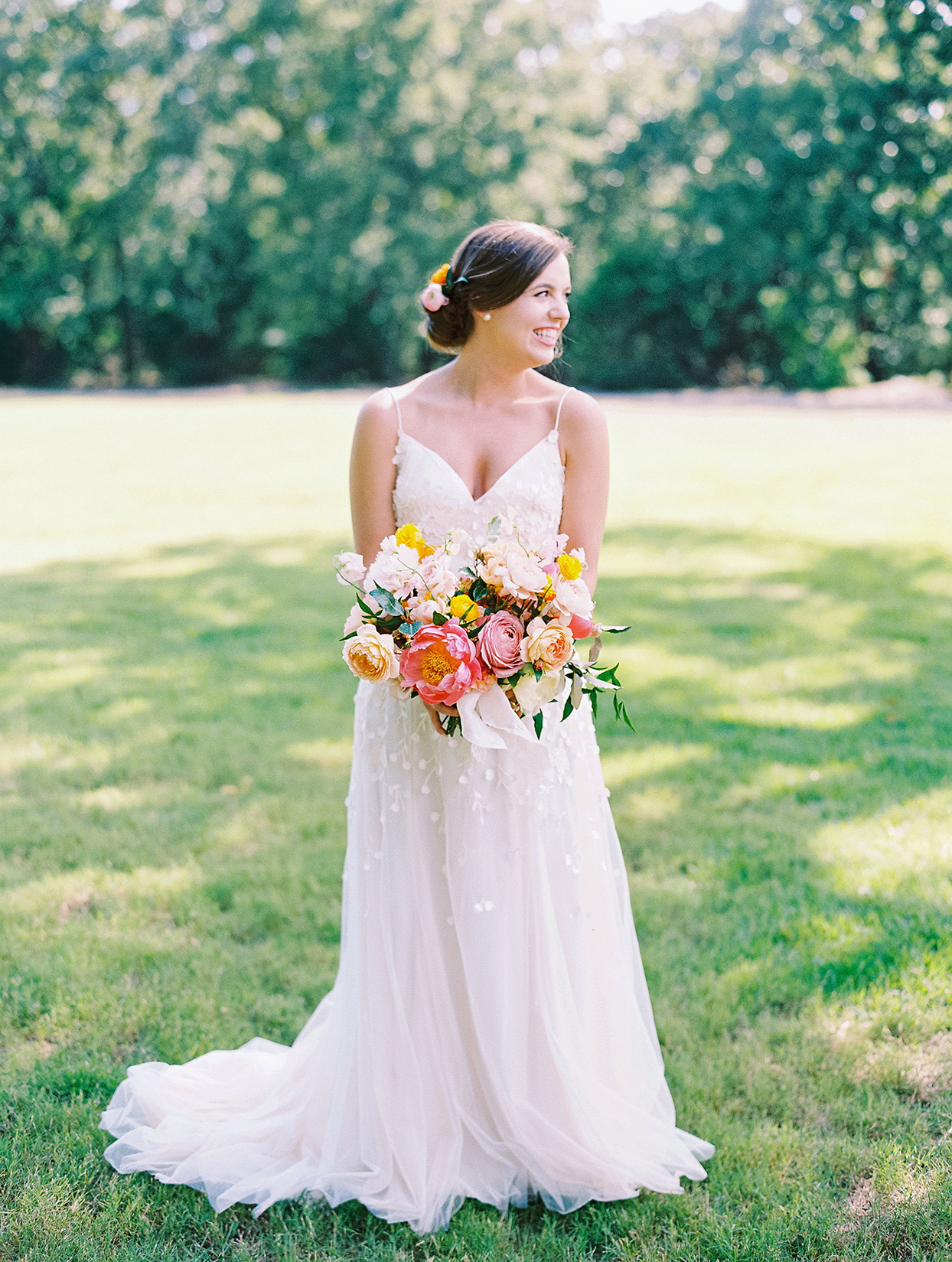 evie joe wedding bride with colorful bouquet in field