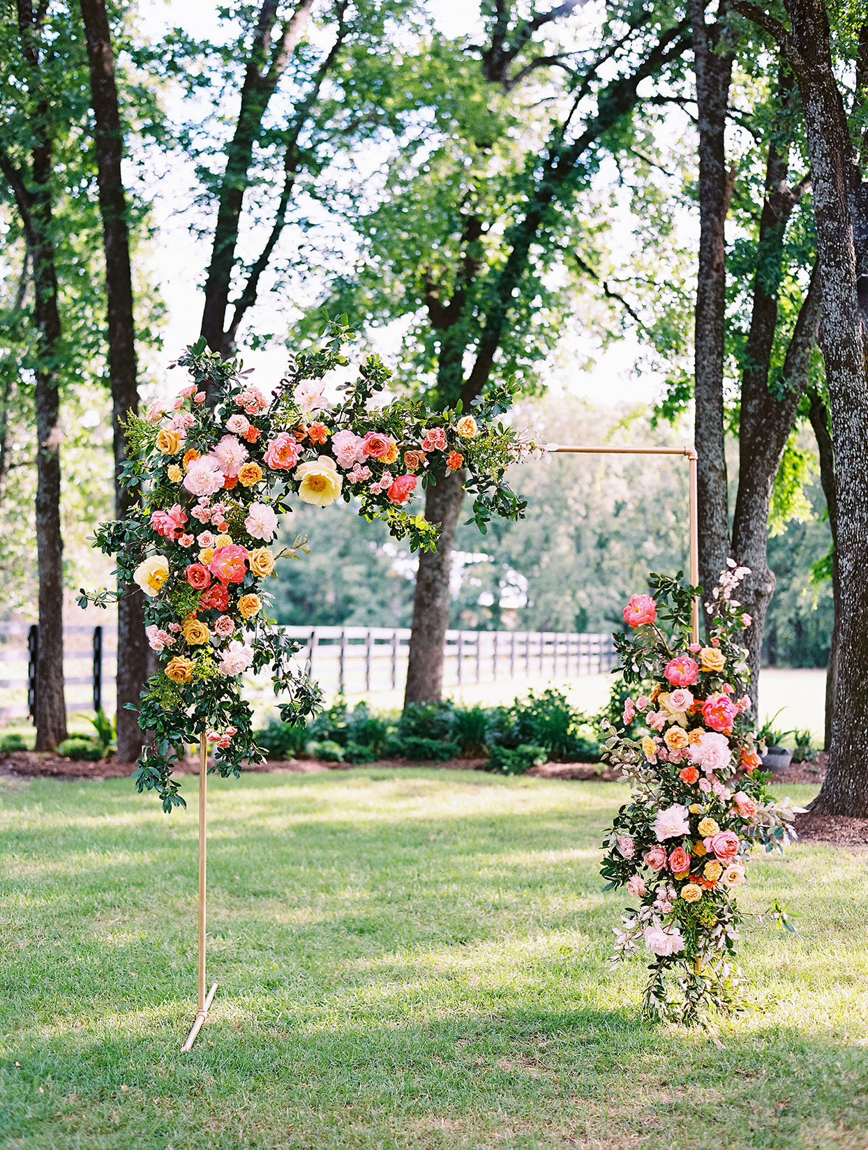 evie joe wedding ceremony floral arch