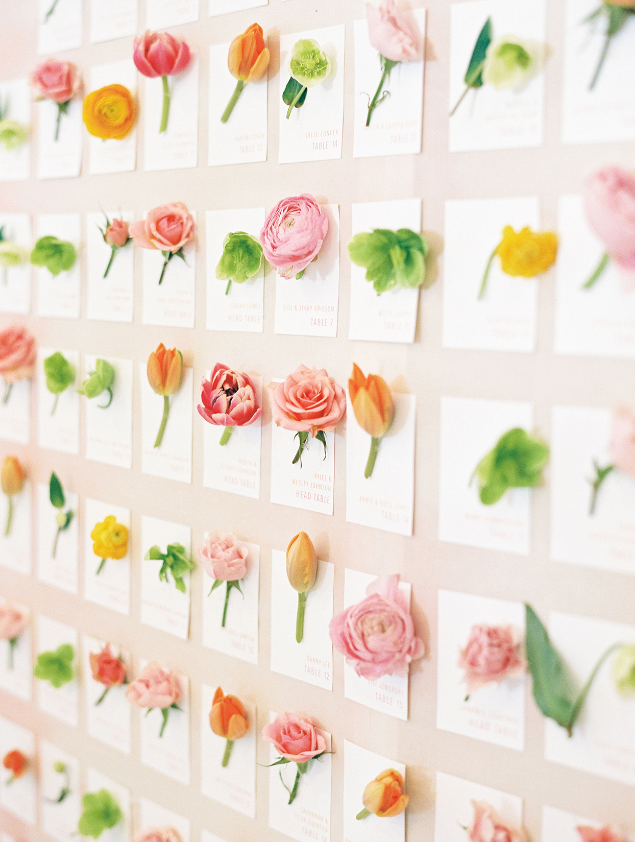 evie joe wedding wall of escorts cards with flowers