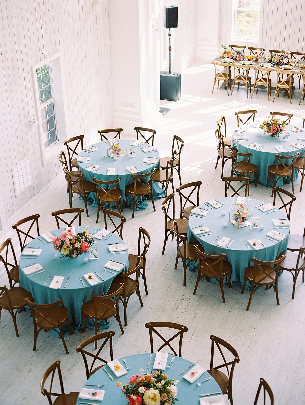 evie joe wedding reception round tables with blue cloths