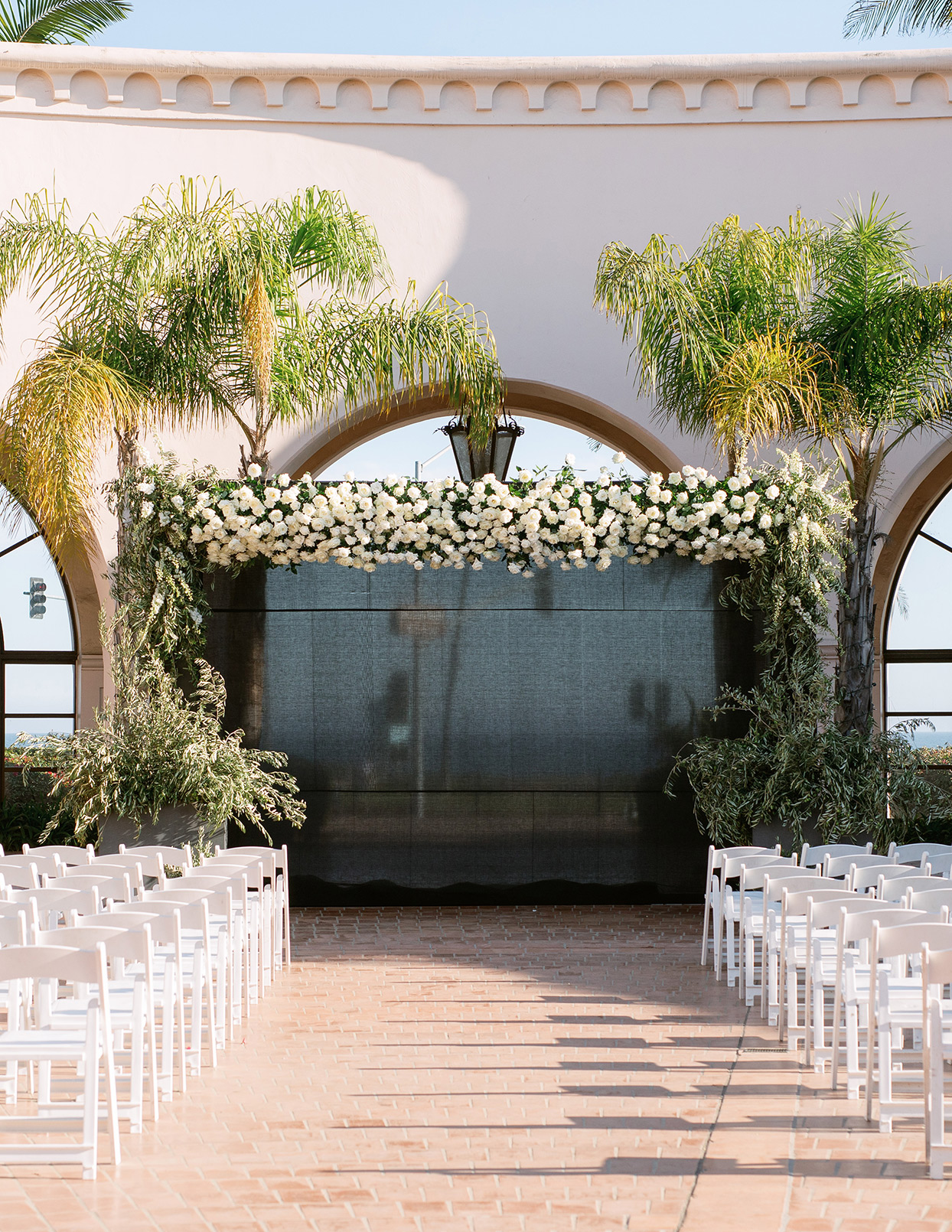 jason justin wedding ceremony white floral arch