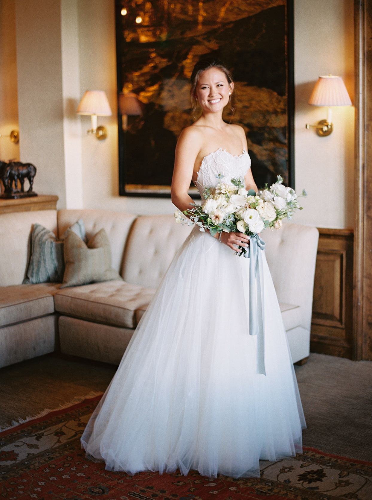 kimmie mike wedding bride in living room with bouquet