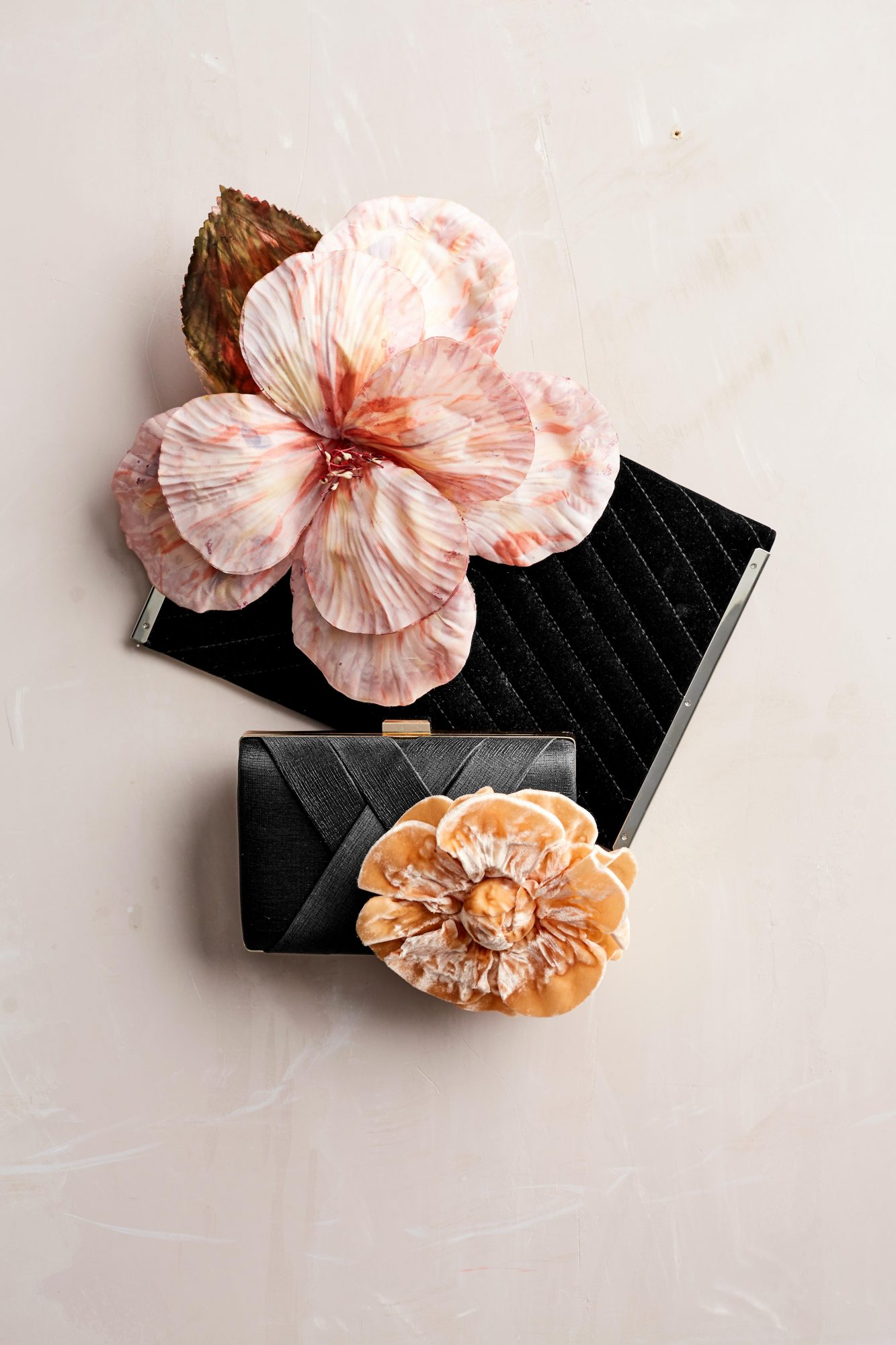 Clutch bags with decorative flowers