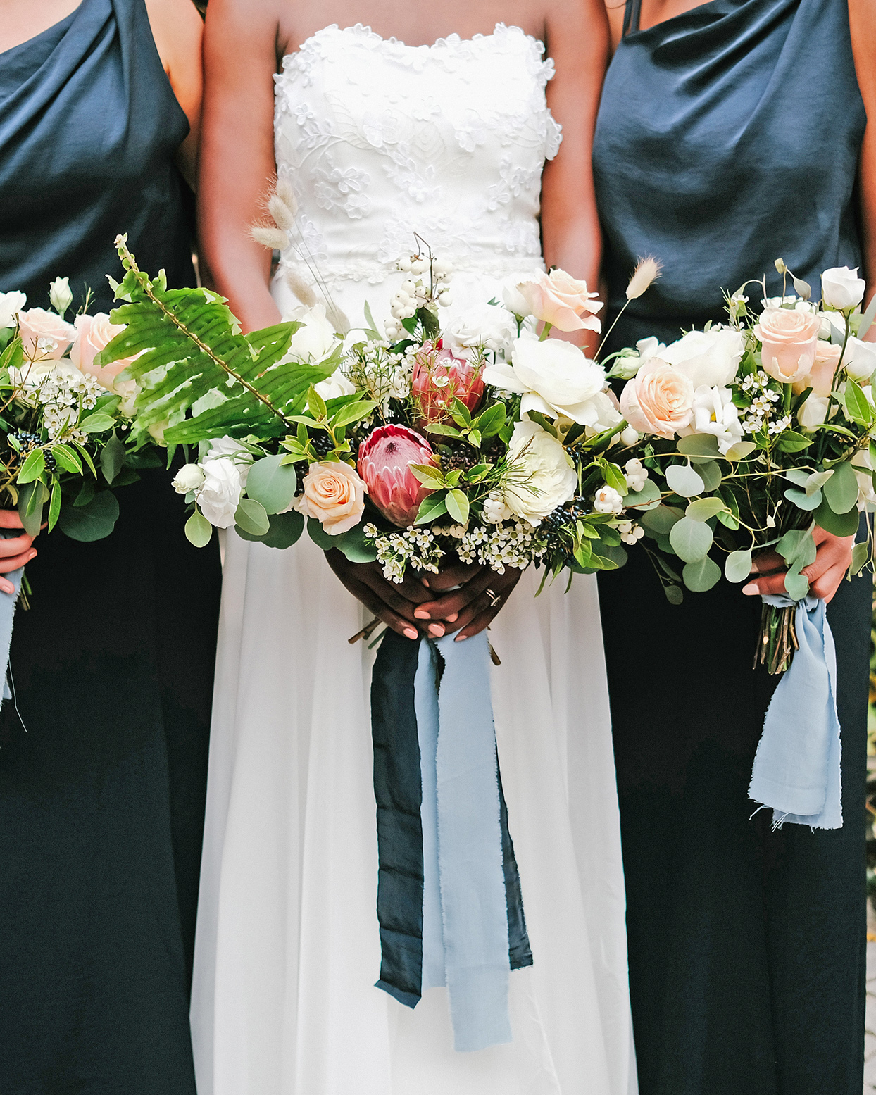emily scott wedding bride and bridesmaids with bouquets