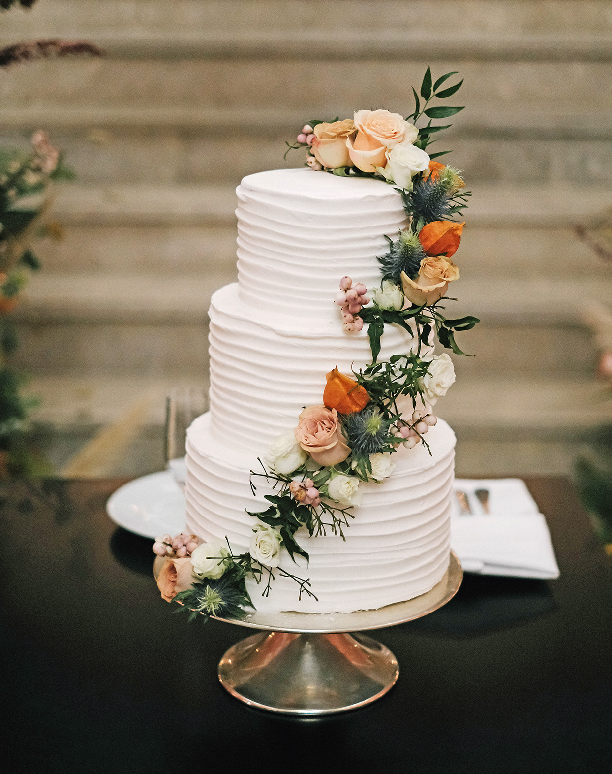 emily scott wedding cake with flower garland