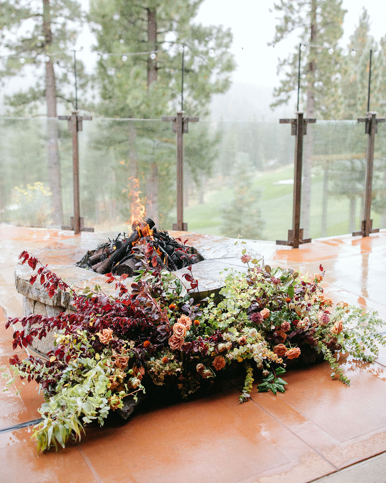 clare tim wedding ceremony floor florals next to fire pit