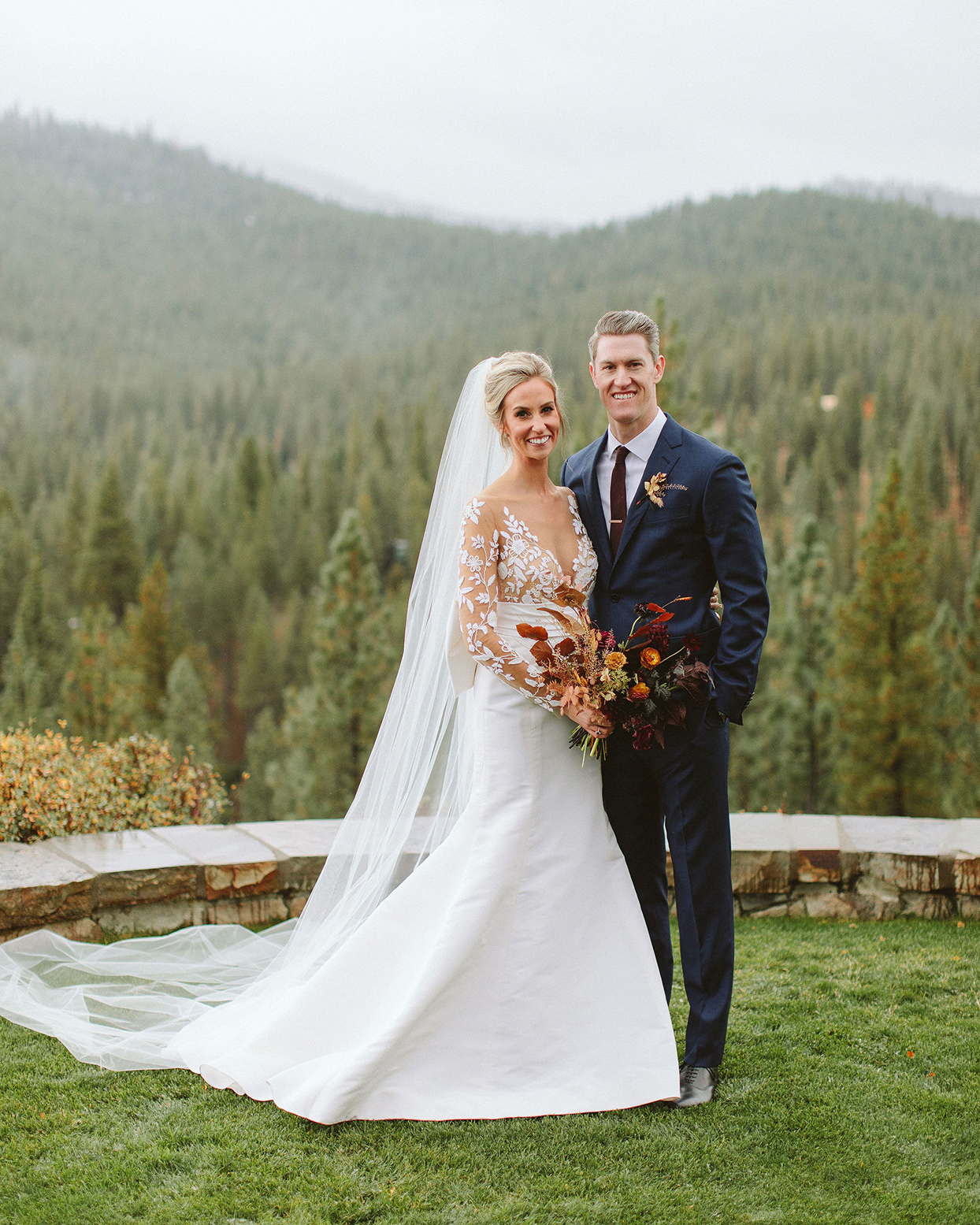 clare tim wedding couple against mountain backdrop