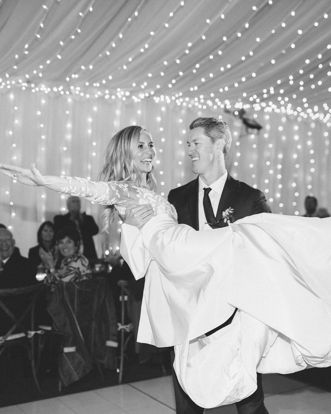clare tim wedding groom carrying bride during dance