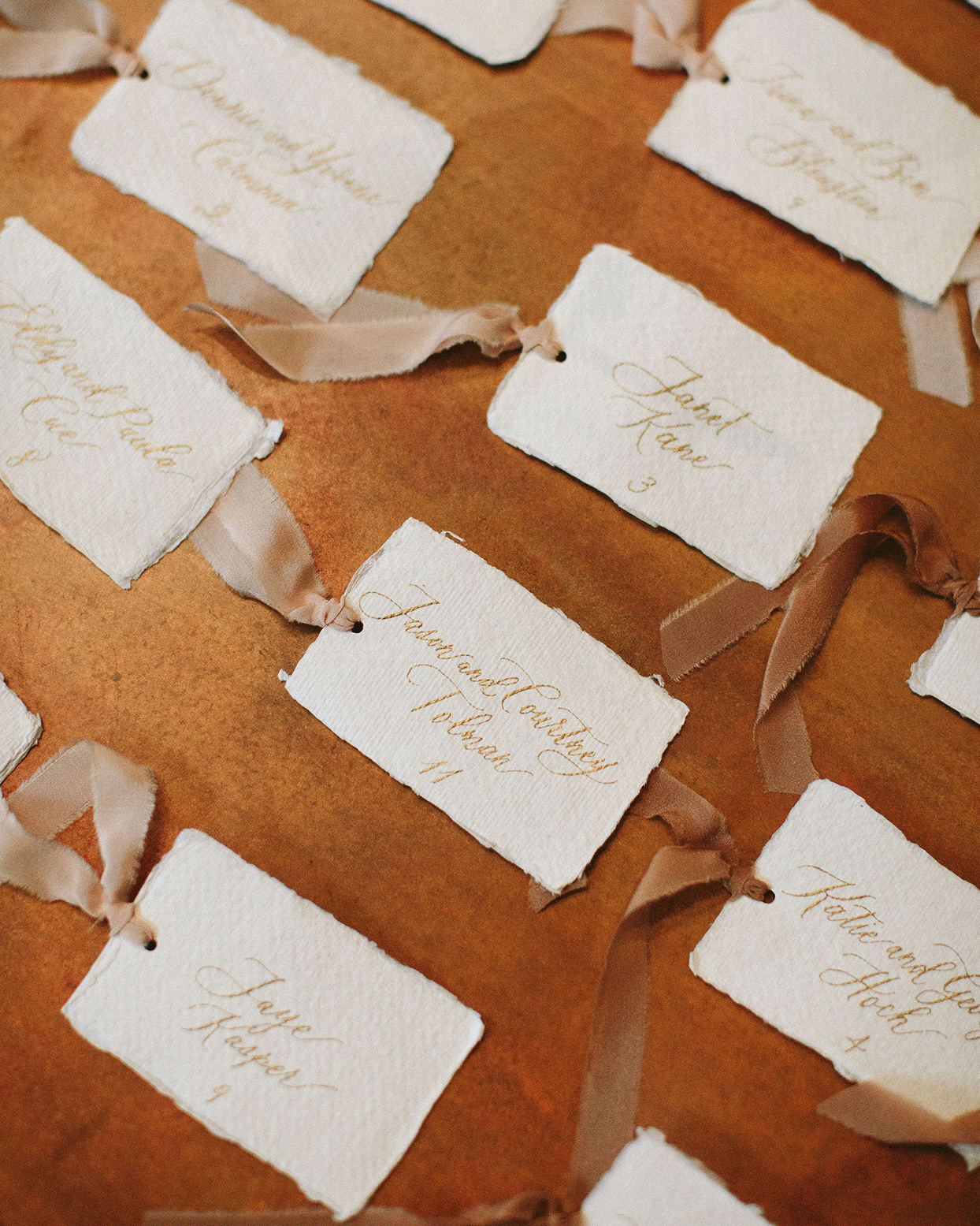 clare tim wedding rustic parchment escort cards with brown ribbons