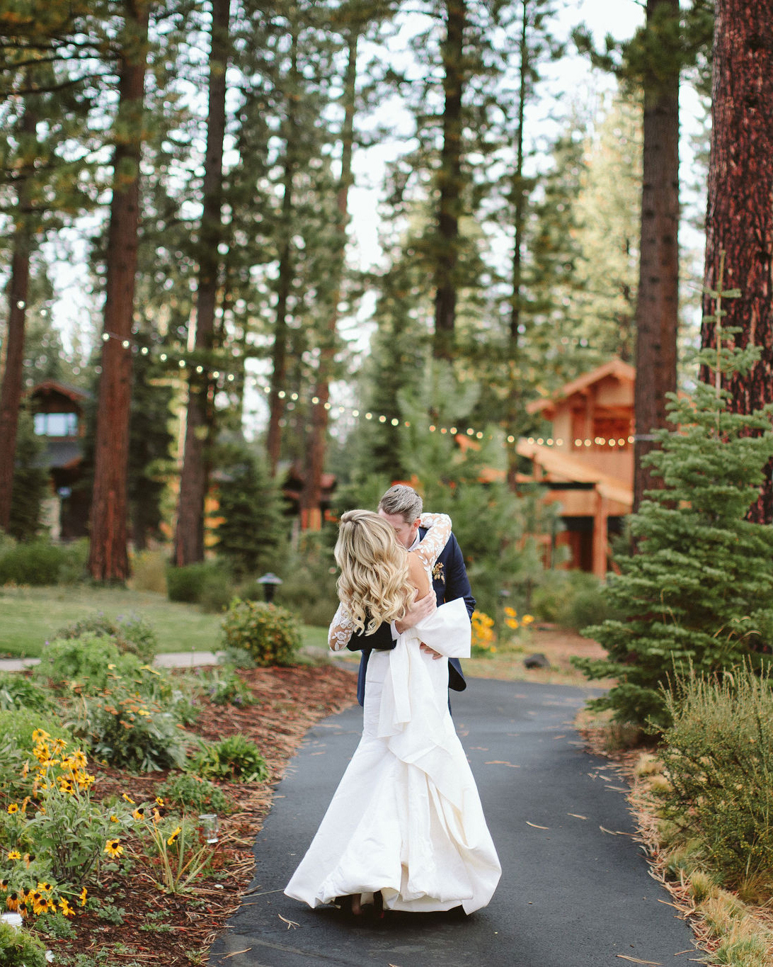 clare tim wedding couple hugging on pathway on trees