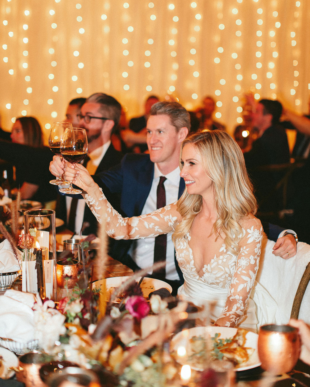 clare tim wedding couple toasting during reception