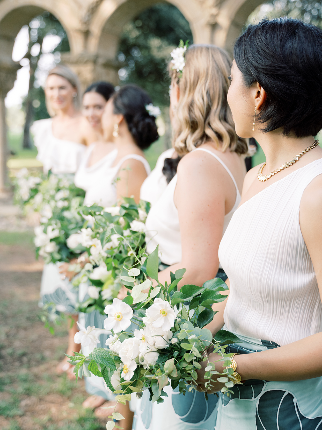 alyssa macia wedding bridesmaids in white and teal holding flowers