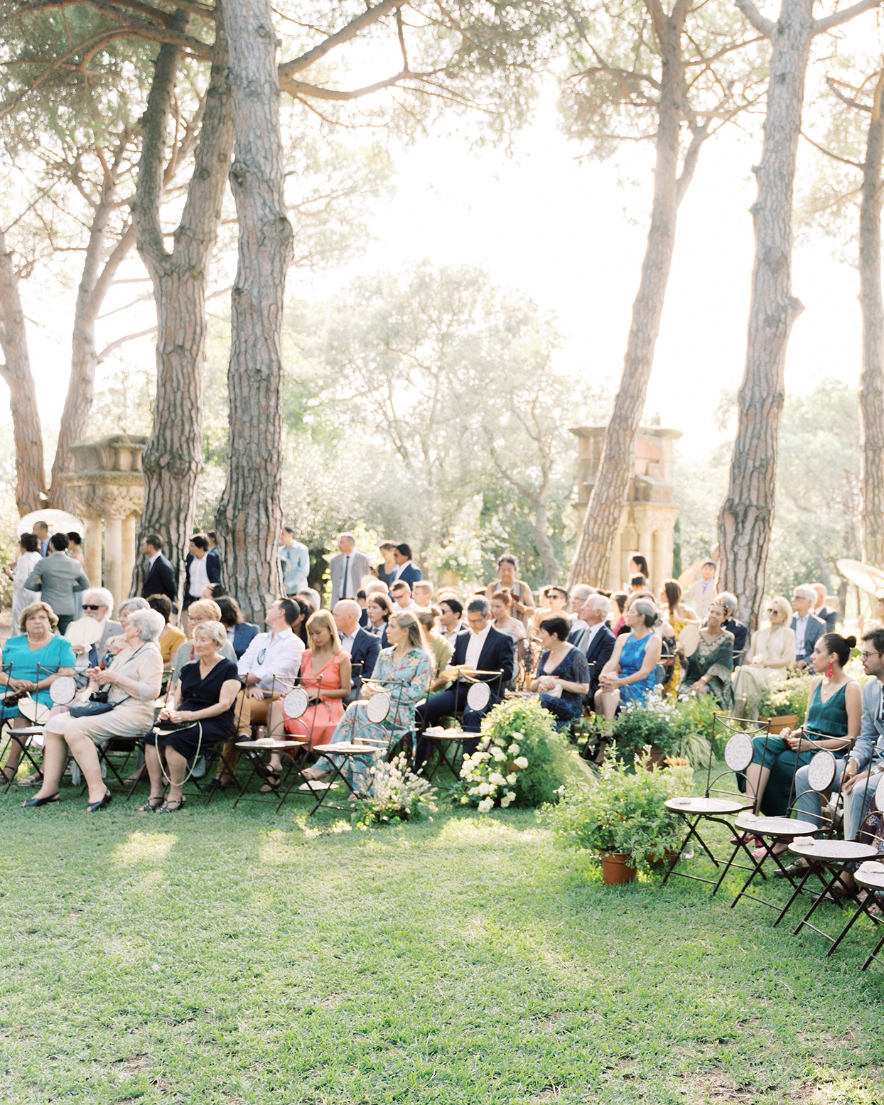 alyssa macia wedding guests seated in chairs for outdoor ceremony