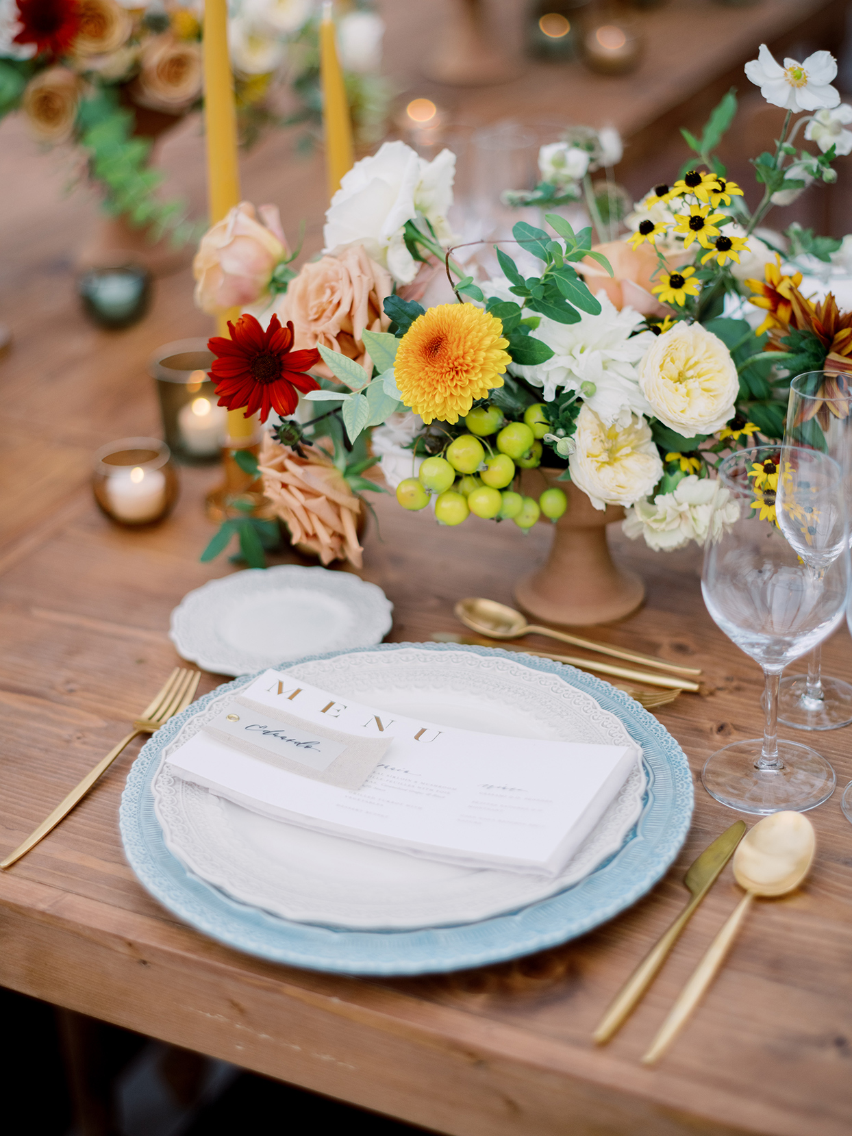 alyssa macia wedding reception ornate place setting and flower centerpiece