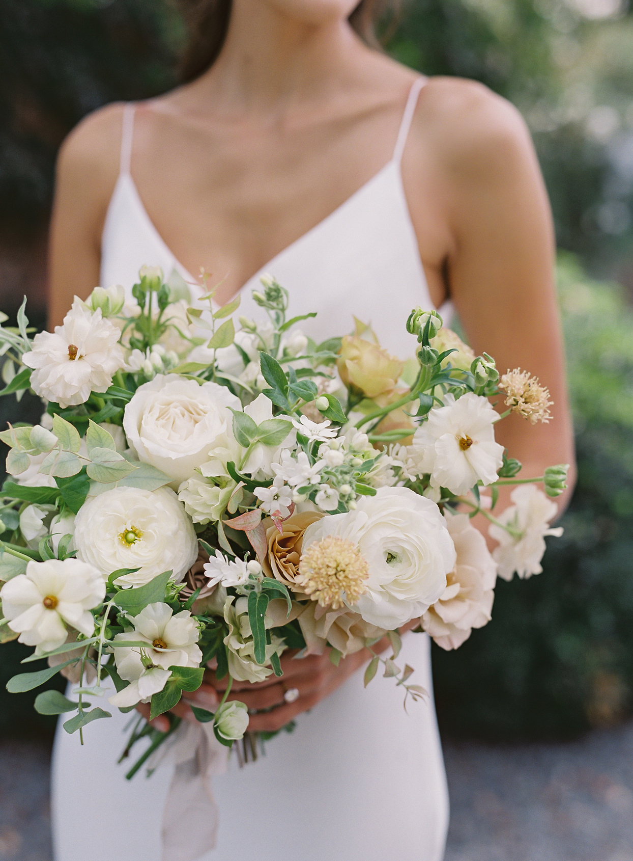 Bride's bouquet with Butterfly ranunculus, scabious, hydrangeas, strawflowers, hellebores, lisianthus, and garden roses