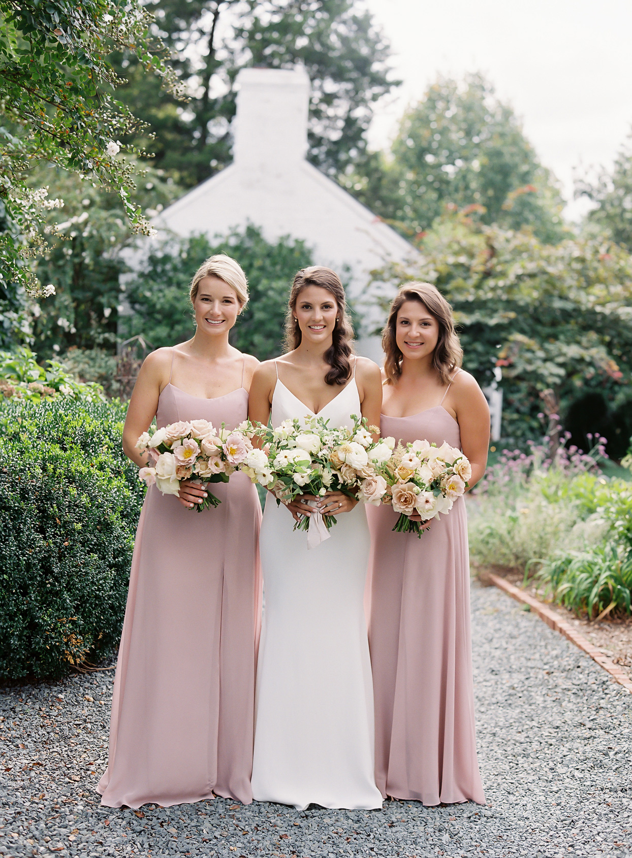 Bridesmaids in Jenny Yoo gowns in dusty rose