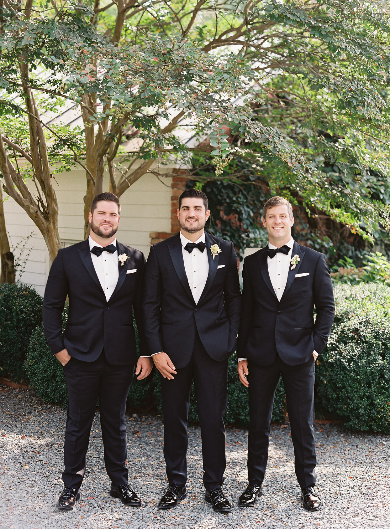 Groomsmen and groom in classic black tuxes