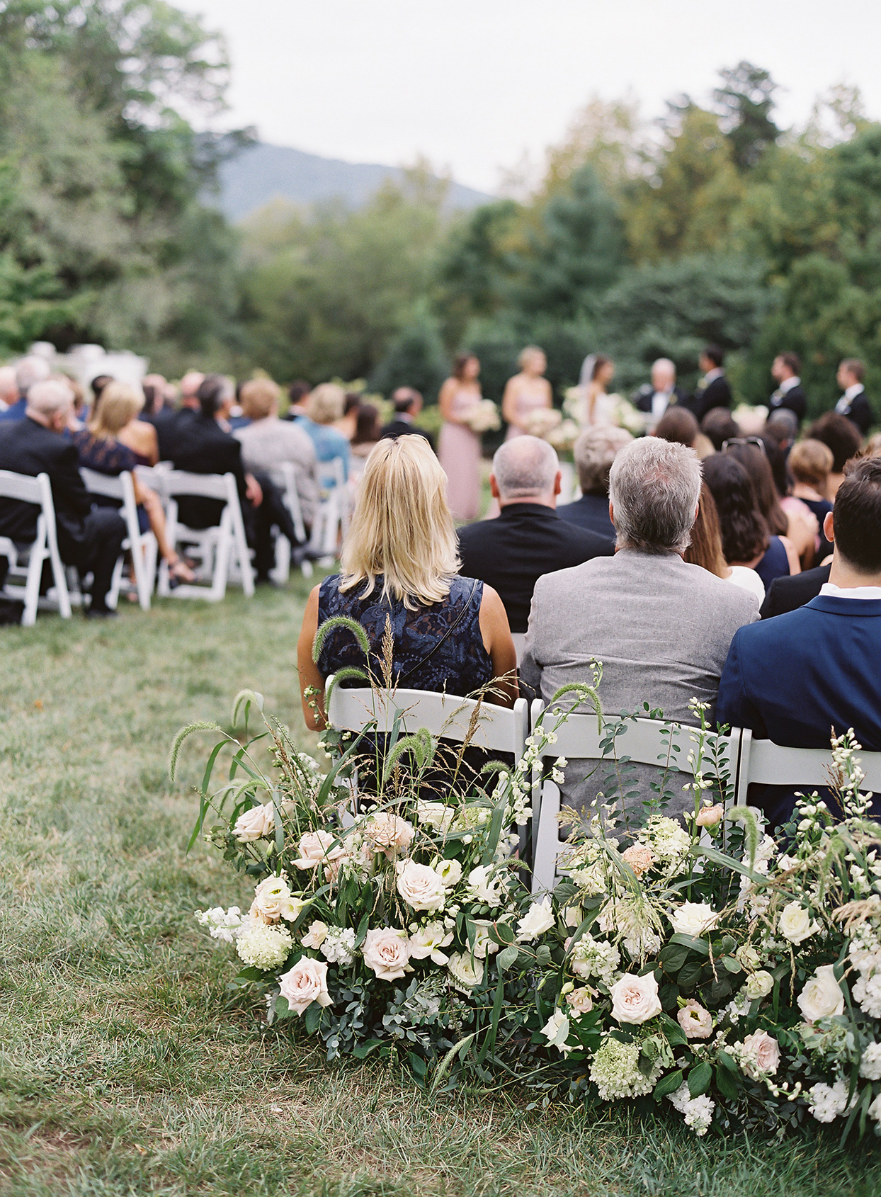 Flowers in the last row of a wedding ceremony