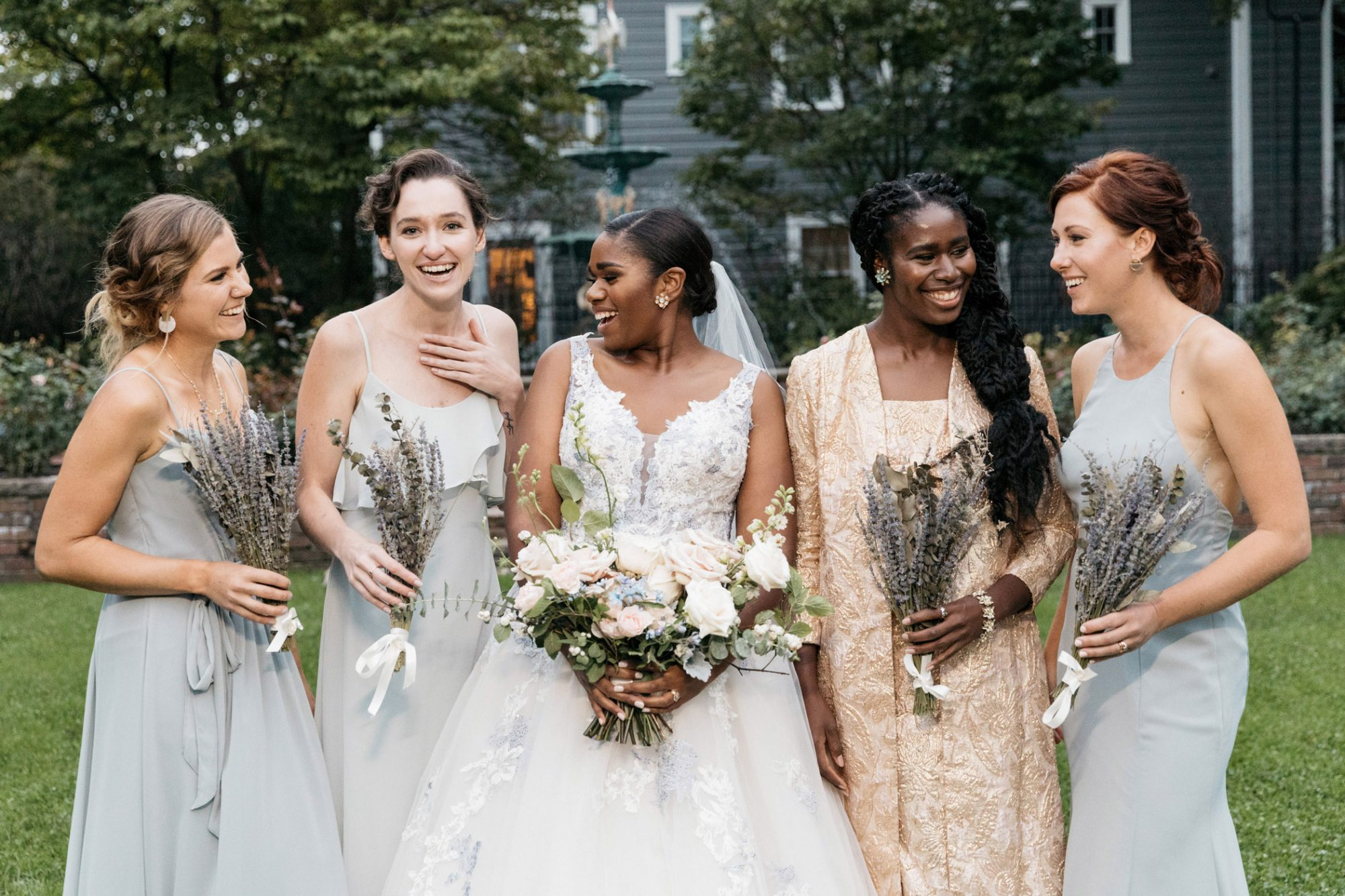 bride with four bride's maids outdoors