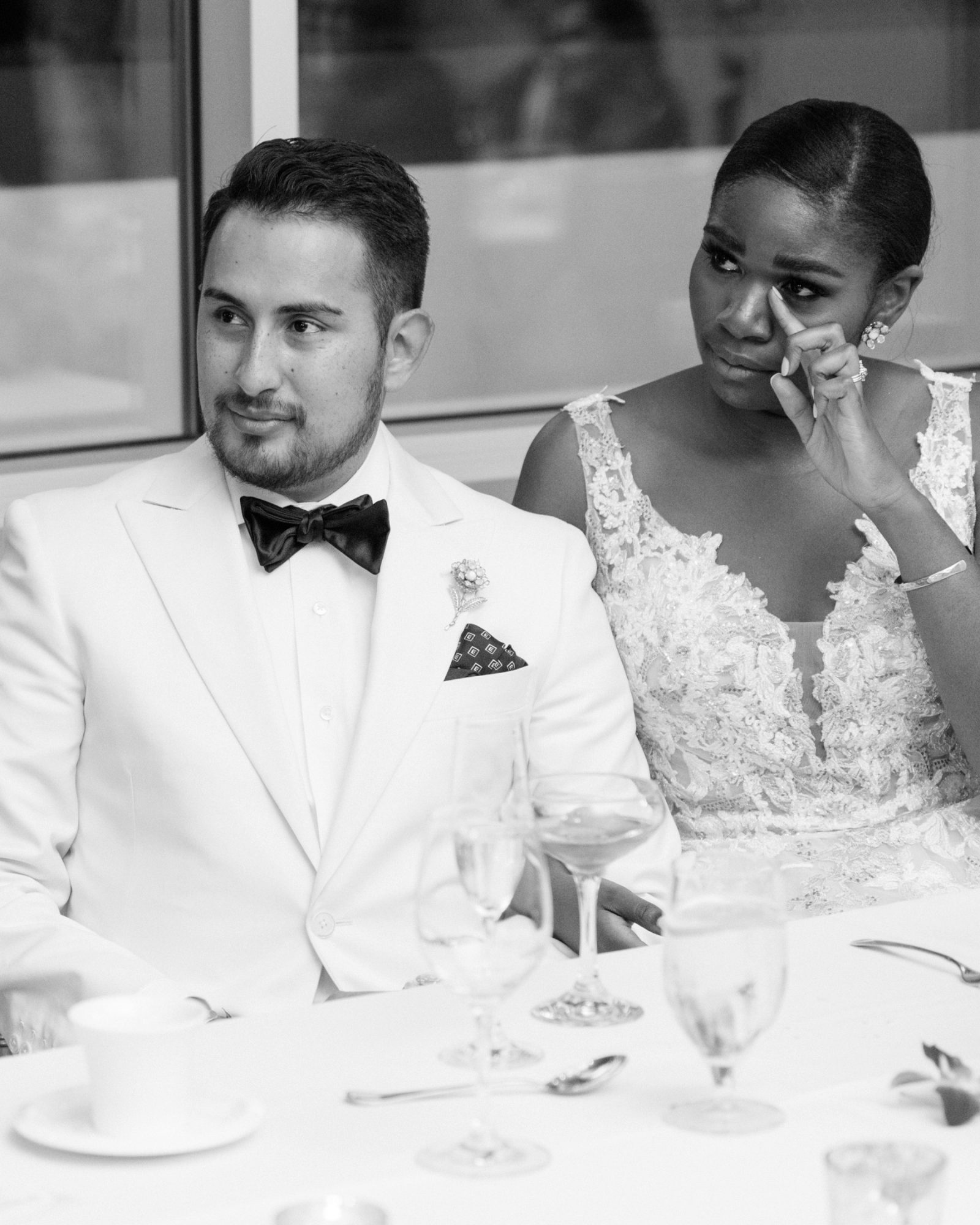 black and white photo bride and groom at reception table