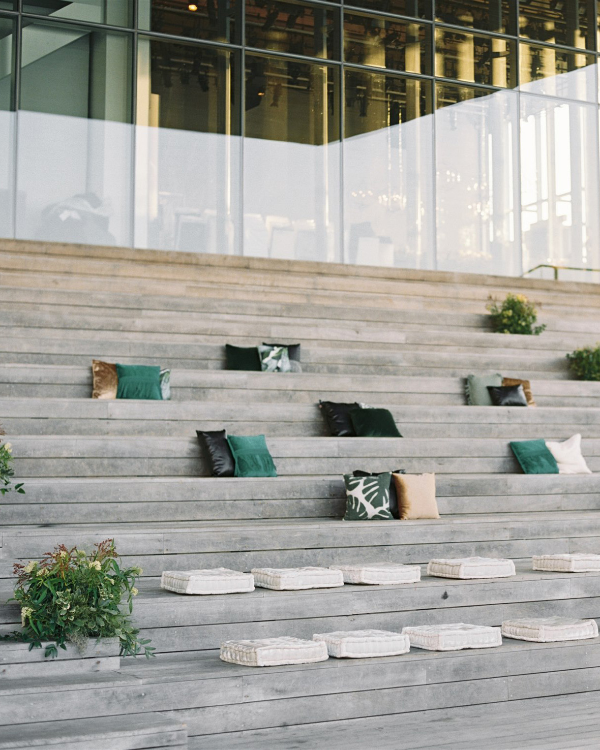 wooden bleachers with cushions and throw pillows