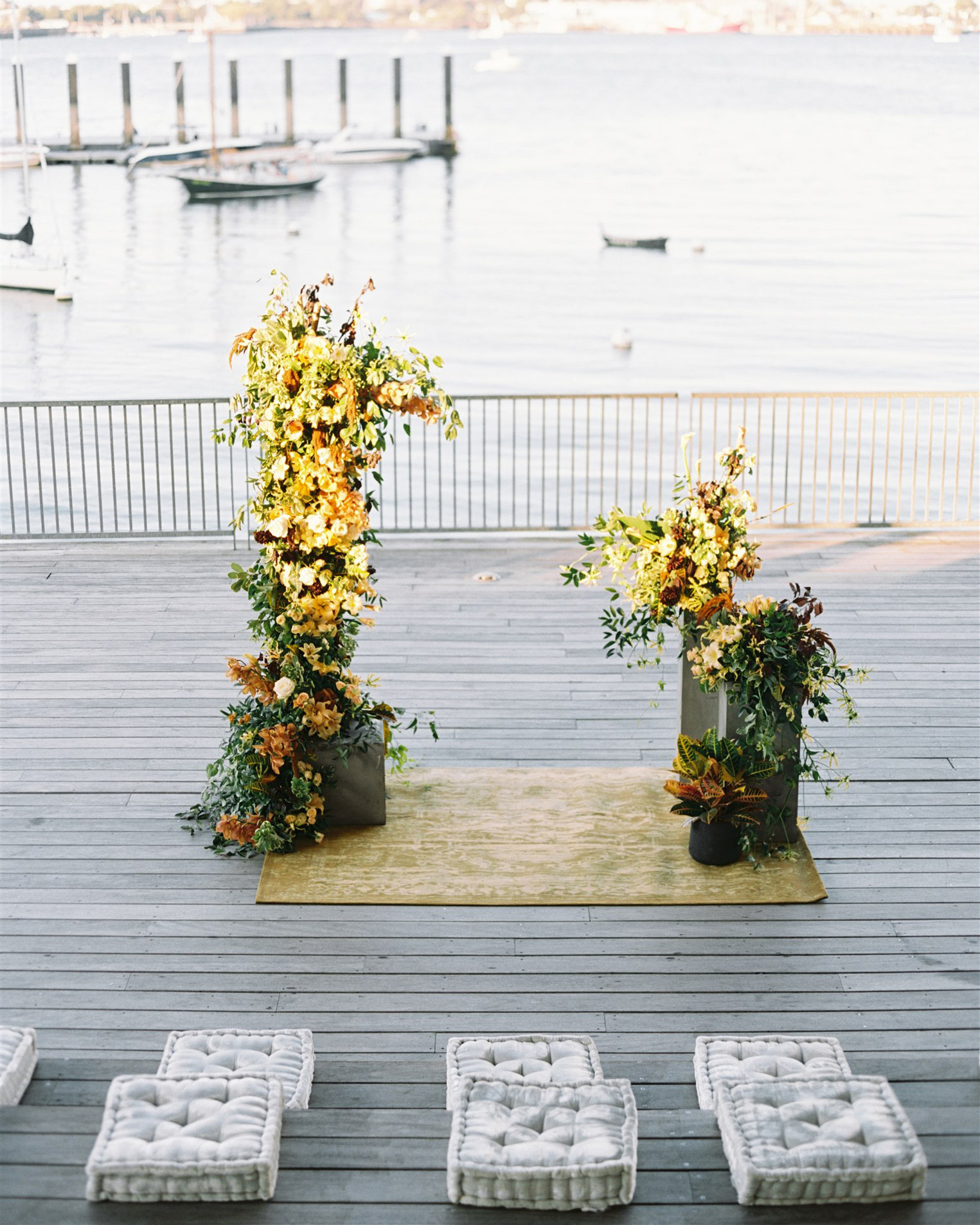 altar on deck with fall flower arrangements water and dock in background