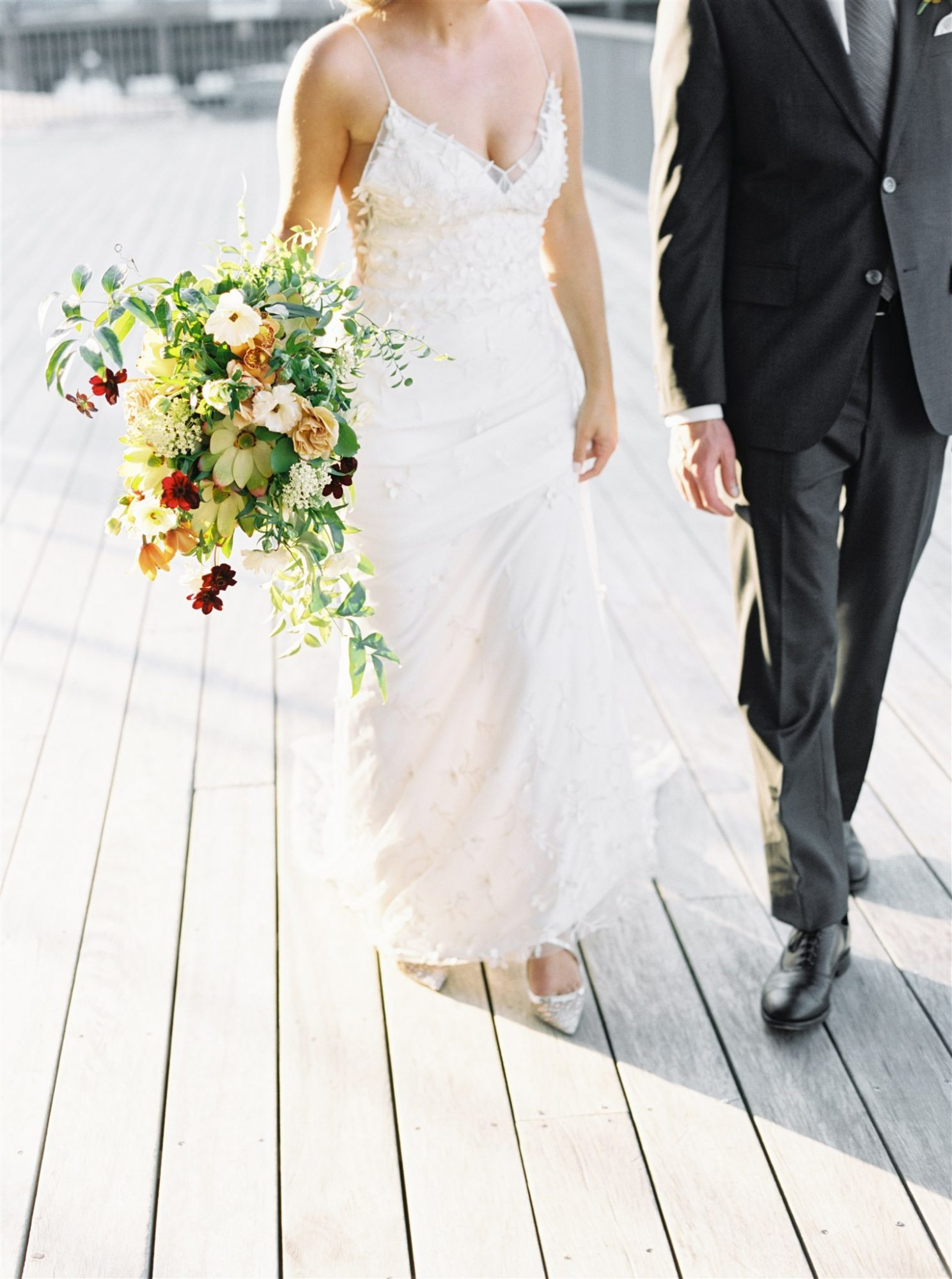 outdoor close-up bride's dress and bouquet