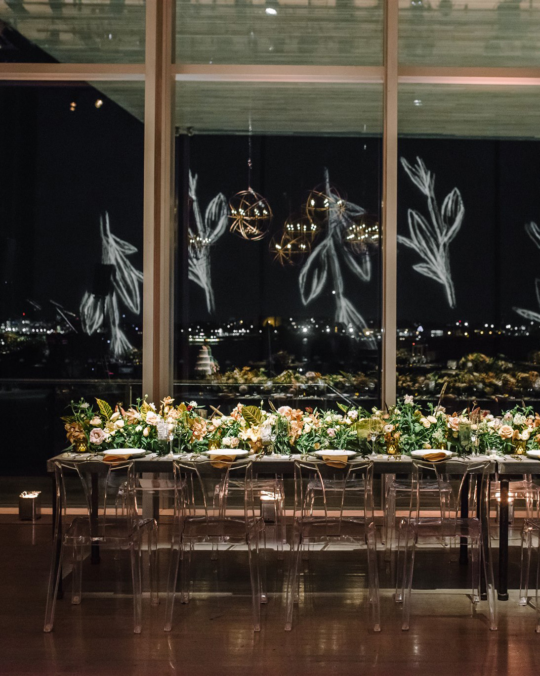 reception table with outdoor night view table-length floral centerpiece