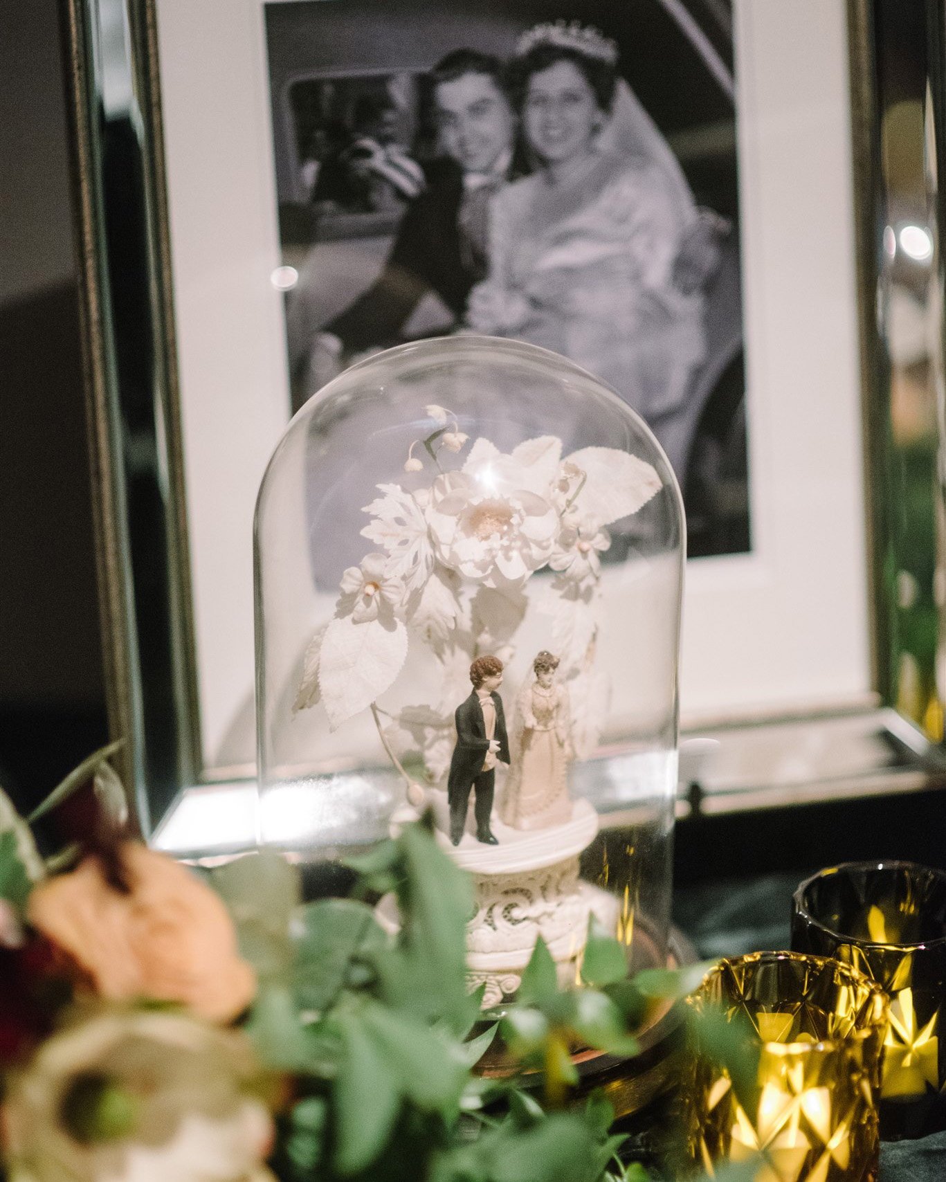 porcelain wedding cake topper in glass dome case