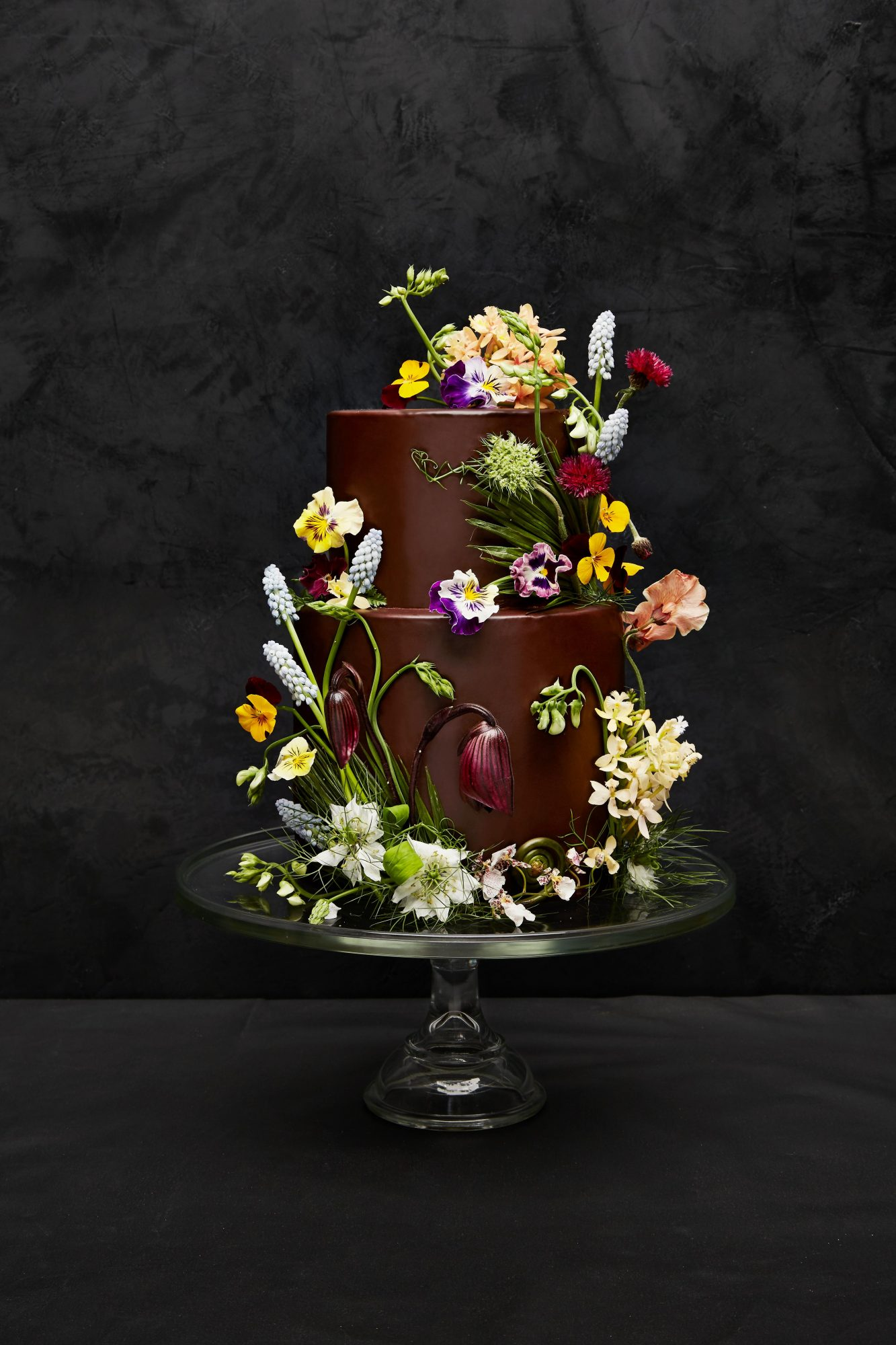 Tiered chocolate cake with flower decor