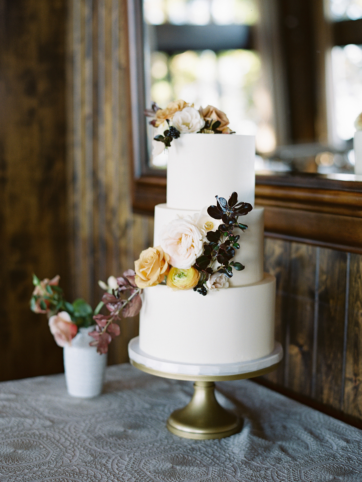 alexandra david wedding three tiered wedding cake with flowers
