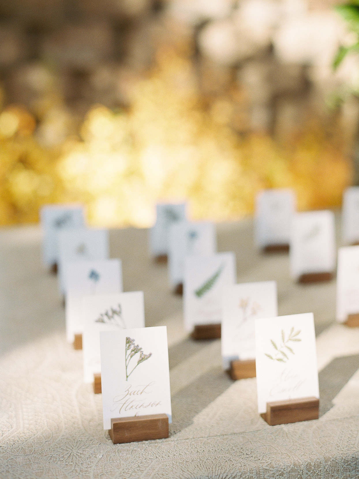 alexandra david wedding escort cards in wooden holders